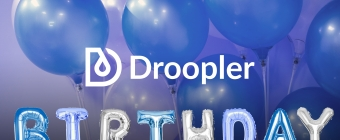 "Droopler logo. Below, there are several hands holding baloons in shape of letters that are arranged to form a word ""Birthday"". Round, blue baloons are set as a background."
