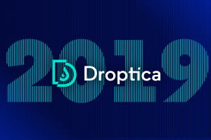 "Droptica logo. In the background, there's ""2019"" text"